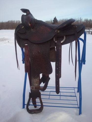 Western saddle and assorted western tack