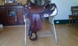 """14.5"""" Circle Y Equitation Show Saddle.  Dark Oil.  Semi-QH bars, great condition.  Very comfortable to ride in!  I am looking for a cutting saddle (15.5"""" seat preferred.)  would consider possible trade and/or $.  This saddle comes with a padded cover/"""