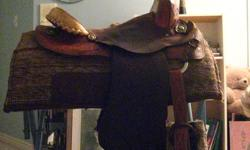 """Older 14"""" Longhorn western barrel saddle for sale. Leather with a suede seat. It would fit a child well, or a small adult. It has Semi-quarter horse bars. Older durable leather, lovely tooling on the skirt and pommel. Pad pictured is included in sale"""