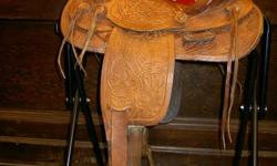 Good solid, nicely tooled Western Saddle.  Just $299 Leather is in excellent shape. Great Christmas gift! HarrowsmithHorseCountry.com 4930 Hwy #38 in Harrowsmith, just 15 minutes north of the 401 and Kingston. Hours: Tues, Wed, Thurs, Fri 9-5:30, Sat 9-5,