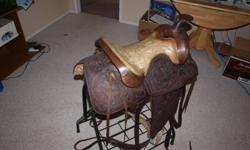 """We have a 14"""" Western Saddle and a folding Saddle Stand for sale. $100.00 OBO."""