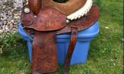 """14"""" Martha Josey saddle in excellent shape. Well looked after. Very comfortable. Fits horses with high withers. Comes w/ front and back cinch. Asking $950.00. Will consider Payments. You are welcome to try out the saddle. Located in Salmon Arm area. This"""