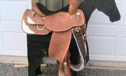 "151/2 "" western show saddle in excellent shape, retail value $2300 , selling for $1200.  Comes with bridle, breast plate and saddle pad to match.  The silver design is the the gold berry silver pattern.  Saddle pad is gold and silver metalic.  This is a"