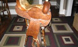"Nice 15"" barrel saddle. Some discoloration on suede seat. Not as noticeable as is in picture. Comfy ride. Very pretty saddle. Text 690 8003"
