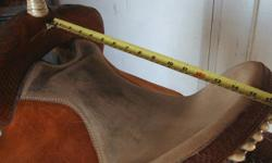 """Used 15"""" Frontier Saddle. This saddle fit most horses.  Barrel Racing saddle .It is a natural color,roughout fenders, F.Q.H Bars ,Cantel 5"""", Gullet is 7"""" . Very good condition .O.B.O"""