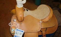 Heavy duty David Motes roping saddle for sale. 15 inch seat, heavy duty rear cinch. Made by Saddle Smith of Texas. This saddle is brand new, never been on a horse, turned sturips, and is excellent quality. Call Ron at 529-6900 to view