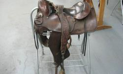 15 inch slick fork saddle with breast collar.  phone 250 379-2078 or cel 604 850-4238