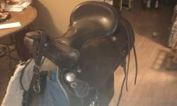 """15"""" Western Rawhide Pleasure/Trail Saddle. Chocolate brown, semi-qh bars, in amazing condition. New back cinch, new 34"""" cinch, matching chest strap, saddle blanket. Padded leather seat.  Please contact for more information."""