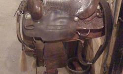 "This here saddle IS A BEAUT, 31 year old Trophy Billy Cook Cutter! Specs: 16"" Full QH Bar 31 Year old Trophy Leather-Rawhide Rear Chich, Off billits and tie straps And remarkable tooling! Details: This was the prize saddle for the 1500 Limited Non-Pro"