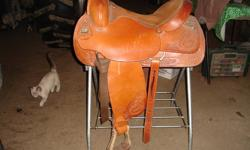 Not even broke in yet.  Comes with brand new Billy Cook breast collar. Full QH bars.