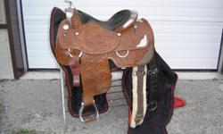 """16 """" Circle Y Show Saddle. This is a close contact saddle loaded with silver, silver horn.  Skirts are Ex-Large for the show ring. This is being sold as a package deal - Saddle, Bag, 2 Cinches and Stand. Price is $1750.00 plus tax. Trades are accepted."""