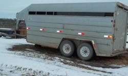 """1999 16 ft Blue Hills goose neck trailer for sale! 6'10"""" inside height. 5455GV, 2 7,000 lb axles. Tires are 16"""" rubber and 1 year old. There is 1/2"""" treated plywood over top of the fir planks. This trailer is in good shape. Phone Jim at 204 773 6975."""