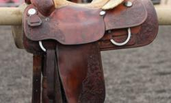 Older model Billy Cook saddle for sale. Great condition, however does have a very minor signs of age. This saddle is extremely well built and sturdy, very solid with gorgeous tooling. Show quality saddle, great for someone looking for a saddle without