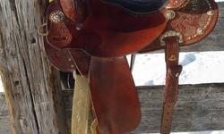 16 inch pozzi pro barrel saddle, bought special order in 09, only one of a kind, smooth out, swade seat, lots of bling!! sold my barrel horse so I don't need this saddle any more, fits all of my horses! real nice saddle, paid 3150.00 asking 2500.00 only 2