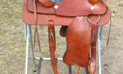 """Decently built lighter weight saddle with good leather and carries a model number on the latigo carrier. Maker unknown. Fibreglass tree, 4"""" cantle. Saddle strings go through the tree. Will fit a wide horse. Is comfortable to ride. Full rigging, mid"""