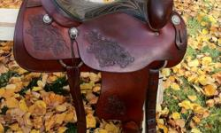 """Gorgeous 16"""" saddle King of Texas. Fits wide horses. It is about 20 years old. In excellent condition, very well cared for, has always been kept indoors. Well made quality saddle. Has rawhide stirrups, good fleece, solid horn & tree. Can be used for show,"""
