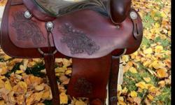 """Gorgeous 16"""" saddle King of Texas roper saddle. Fits wide horses. It is about 20 years old. In excellent condition, looks new, very well cared for. Has always been kept indoors. Well made saddle. Has rawhide stirrups, fleece looks new, solid horn & tree."""