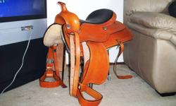This is a very nice saddle only used a few times, I'm going to buy a roping saddle.Asking 600.00 0B0