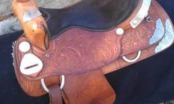 "Saddle is in great shape used for horse shows. Light oil, 16"" with lots of silver."