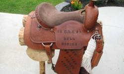 """16"""" Western Saddle made by AWL Leather Works in Didsbury Alberta. This saddle was made for the 25 Anniversary CRA Bull Riding and is in very good condition and shows very little use, it is complete with front and rear cinches and ready to be used. We are"""