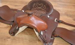 16'' Western Saddle. Light Weight, Thin Leather. Suede Seat. In Really Good Shape. Comes With Breast Plate, Briddle and Reins. Priced To Sell...... $400.00