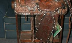 """Quality 16"""" western saddle, with breast collar, rear girth, pad, bridle and reins. In very good condition. Beautifully hand tooled. Full Quarter Horse bars. Serious only inquires please. Call Tom at 882-0958"""