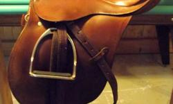 """17"""" Stubben Wotan Saddle for sale with accessories! USED AND IN GREAT CONDITION! A VERY COMFORTABLE SADDLE! (comes with)   - Stirrup Leathers -Stirrup Irons-Leather Girth -4 Saddle Pads -1 Wedge Saddle Pad  (perfect for horses with high withers or"""