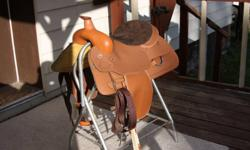 """Light tan western saddle for sale.  16"""" seat, full QH bars.  Lightly used, in GREAT shape!  The widest tree possible without going to a draft size.  Lamicell brand, synthetic easy care.  Asking $300 OBO.  In Williams Lake but also can deliver to Quesnel."""