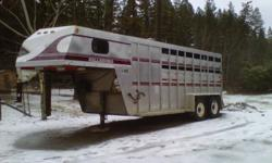 1996 Hillsboro horse trailer with a weekender. Tack room/dressing room with fold out saddle rack, 110V fridge, sink & area for bed. It has a propane heater, a water tank & cupboard space. Open stock type back, it also has a folding tack in the back corner