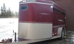 2000 Southland Trailer. 16'  Solid wall front tack with saddle racks, blanket bars & lots of bridle hooks. One removeable horse divider. Hauls three horses or take the divider out & haul livestock.  Upsizing- open to offers.