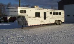 For Sale: 2005 4 Horse Trailer   14 ft living quarters. 7 ft wide. Living quarters has a queen sized bed in the front a dinette that folds down into a bed, couch, ac, fridge, stove, sink. In the bathroom there is a shower, toilet and a sink. Horse