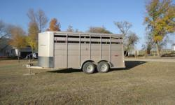 FOR SALE   2009 16' beige Titan Challenger trailer.  Fits 4 horses with a dividing door in the middle.  Like new and only used for short trips.  Bumper hitch. Currently in Brandon, MB but can bring to SK, meet half way, make arrangements, etc.