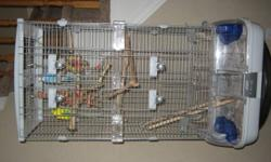 2 young budgies with a good easy to clean cage for sale. They need to go as a pair. If you know anything about budgies you would know they shouldn't be separated after they bond. Many extra's and toys etc. The blue bird is excellent with hands but the