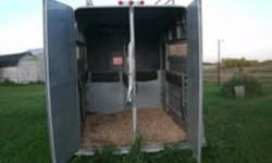 2 horse trailer, in good condition.  Good tires.  Hay rack on top.  Padded stalls. Tack in front.   Come have a look. Make us a reasonable offer.