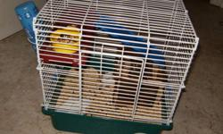 """I have 2 hamsters i need to sell they are $35 each or both for $60. One is a black and white syrian """"Lily"""". She has her own cage food bowl water bottle and shelter to go with her. The other one is grey and white """"Smokey"""" she responds to her name. She also"""