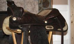 """Barrel saddle, custom made 15.5"""" seat, 7"""" gullet, full QH bars. Used but in very good condition. Silver trim , light weight. Asking $500.00 obo. Big Horn pleasure saddle, 15"""" seat, 7"""" gullet and QH bars. Dark oil in color with silver trim on skirt. Very"""