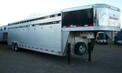 SALES REP DEMO!! SLIGHTY USED.This trailer was custom built for the SOONER/EXISS sale rep to haul his COMPLETE HITCH AND SHOW WAGON, but could be use to haul any livestock. 32FT LONG BED+GOOSENECK,81/2 ft wide,7ft8in high,,3 pens ,front pen has 12 volt