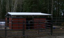 4 Stall BELAN COUNTRY horse shelter for sale.  Only 4yrs old, includes all lumber and tin roofing.  (Cost over $14,000 without lumber and tin).  2 stalls have back doors as well.  Whole structure measure 24ft x36ft.  Currently fully assembled and painted,