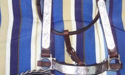 Have 6 Sterling Silver Show Halters to sell, most have attached leads w/chains. All are regular horse sized, used a handful of times, as new. All different styles/silver patterns. $175.00/halter w/lead and $150.00 for halter w/out lead.