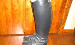 Only worn a few times ..Too big for me.  Gorgeous boots with rear zipper