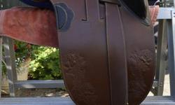 I selling my aussie saddle which includes a cover, felt pad, and two cinches. My reason for selling it is that it does not fit my horse.  I bought it last April and have only used it four times.  would fit a horse with high withers great saddle just