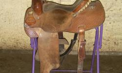"Made by Frontier Saddlery, Claresholm, Alta 15"" seat, roughout seat and fenders"