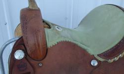 """It is a 14"""" seat barrel saddle. It's make is an Alamo limited edition, it has a higher back with a lime green seat and is all smooth leather, no rough out. Asking $800"""