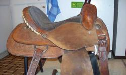 "14 "" Circle Y barrel saddle Excellent used condition.  Fancy saddle. 4"" cantle SOLID tree Aluminum stirrups with rubber tred Close contact saddle (cut away bottom skirt) tooled leather   asking $850.00 offers   Phone or e-mail, 780-581-1111   will send"