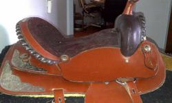"""I have a beautiful Western Show Saddle with a 16"""" seat that I am looking to sell. I have only used the saddle a handful of times. It is a custom made saddle (though I'm not sure of the maker - I was told this when I purchased it a year ago.) I'm asking"""
