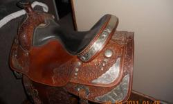 """Big Horn show saddle, 16"""" with LOTS of silver and great quality leather that has been kept in imaculate condition. This saddle had been used for showing and has only had 2 owners. The saddle comes with matching bridle and breast collar, also covered in"""