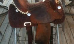 Beautiful saddle! Hate to part but not racing anymore, anyone whos sat in this saddle loves it. 15 inch seat, comes with pro choice cinch and lami cell saddle pad. Ive owned this saddle since new you will not be disapointed, located in Blind River. This