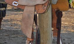 """16"""" Billy Cook Sulphur OK Barrel Racer Saddle. This saddle is Nearly NEW!! Shows a little Wear, Everything is in Perfect Condition. Dark Brown Suede Stitched Seat Basket Tooled. Silver Laced Cantle, Silver Horn cap, Nice conchos. In skirt rigging. Leather"""