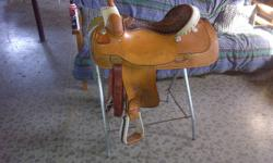 Im selling a beautiful western roper billy cook saddle its not a year old and is in awesome condition i used in for western pleasure and trail riding and has some nice silver on it to show. Tree: Rawhide Bowman tree Seat: 18'' QH bars and it comes with