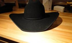 Black felt and Straw cowboy hats in excellent condition Black felt cowboy / western hat in excellent condition - used twice for showing. Size 7 - paid $60 at Bronco's for it. $30 or best offer. Dark Straw cowboy hat - never used Size 7 1/4. Asking $20 or